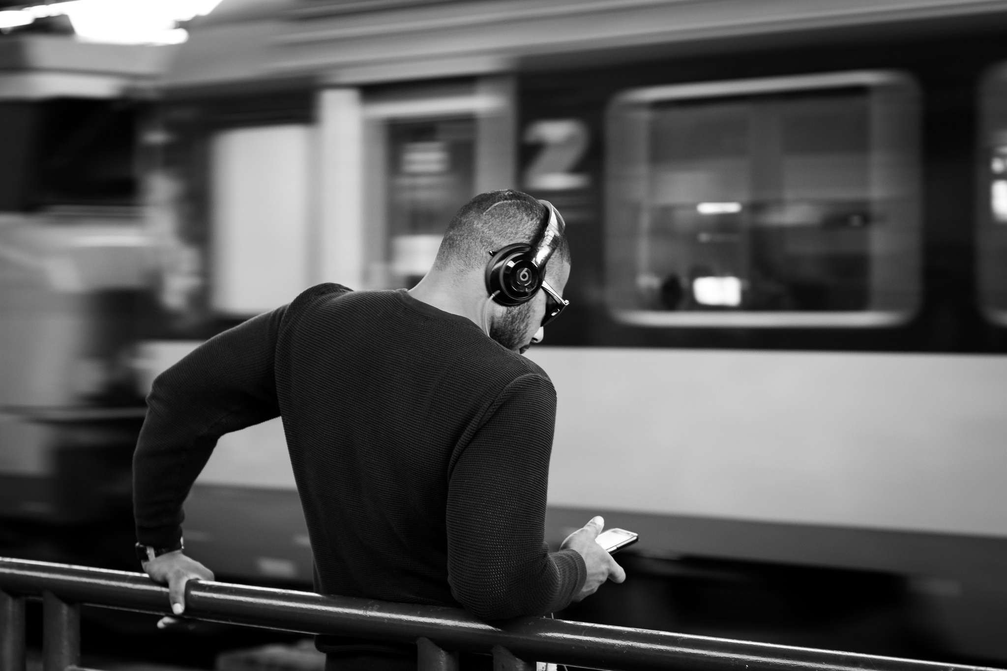 Picture of young man wearing headphones by Gauthier Delecroix